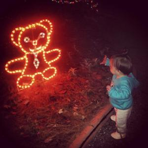 Lil Viv waving at the lighted bear.
