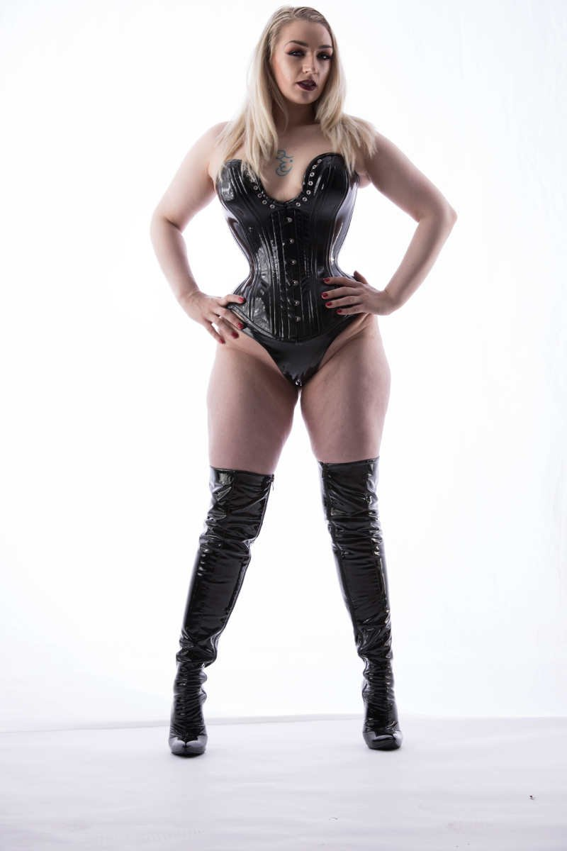 Seattle fetish & femdom goddess ruby enraylls in a tight pvc corset and boots commands you to bow down