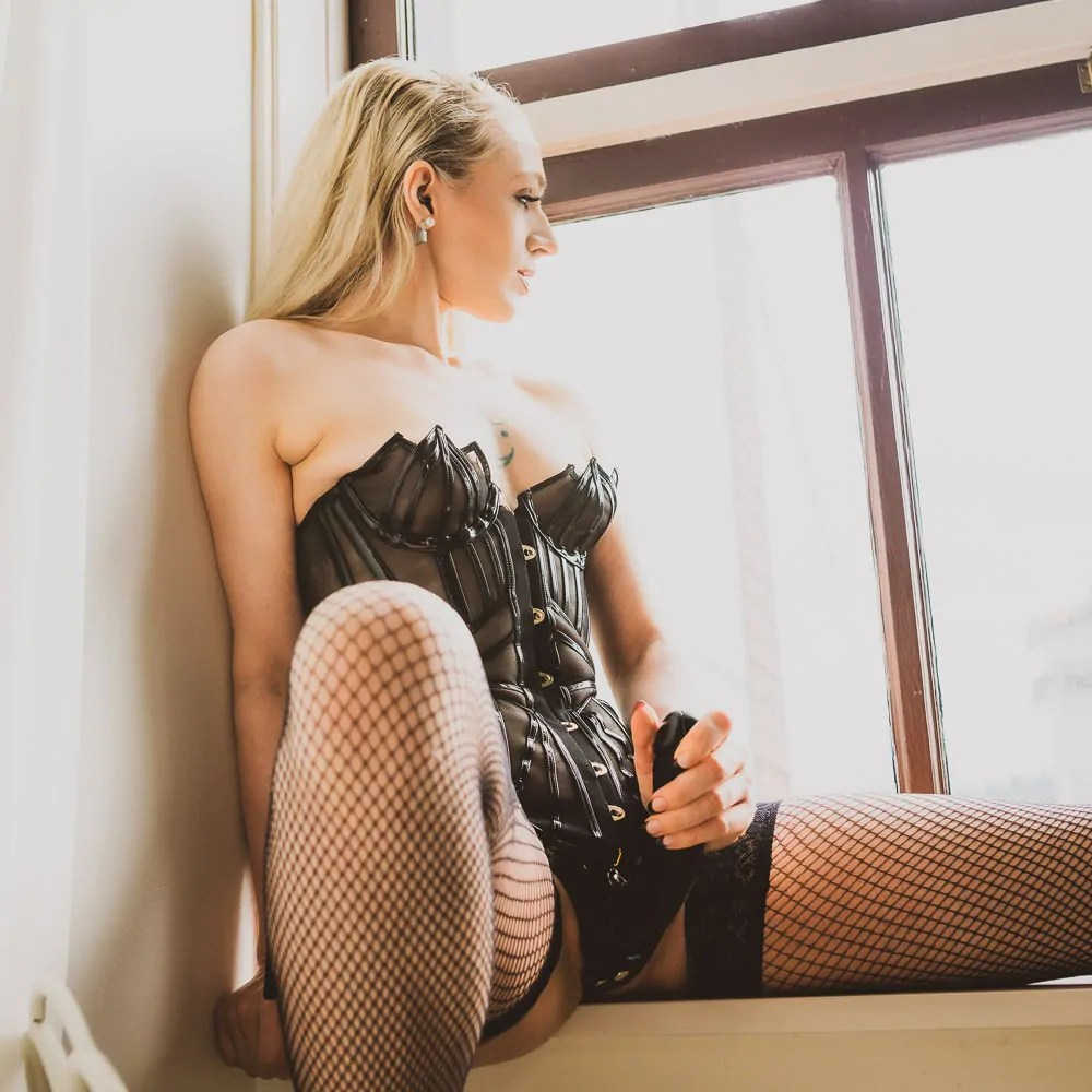 Seattle strapon dominatrix Ruby Enraylls in agent provacateur jet corset and fishnet stockings