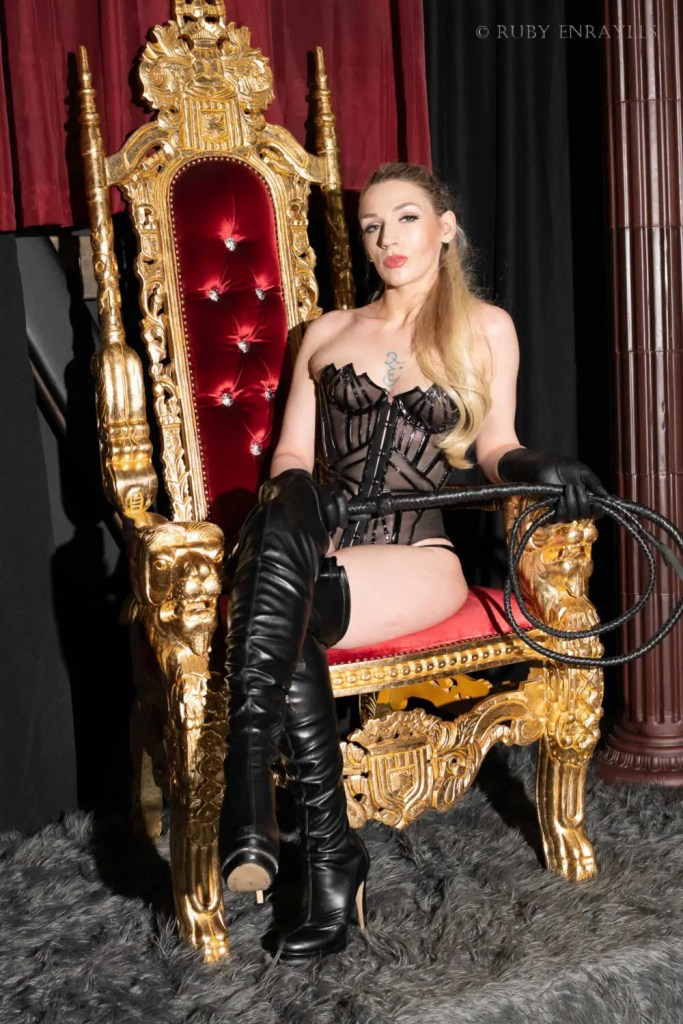 seattle dominatrix ruby on a throne to be served by her slaves