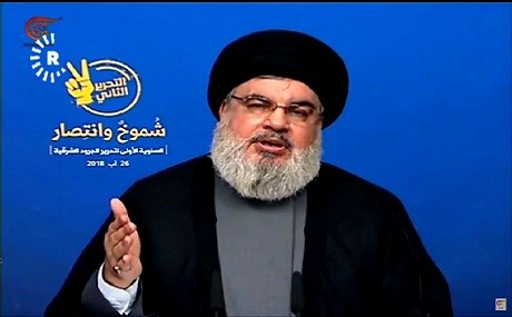 Hassan Nasrallah, head of the Lebanese Hezbollah, broadcasts a speech on the group's Al-Manar channel, August 26, 2018. Photo: Al-Manar / Rudaw video