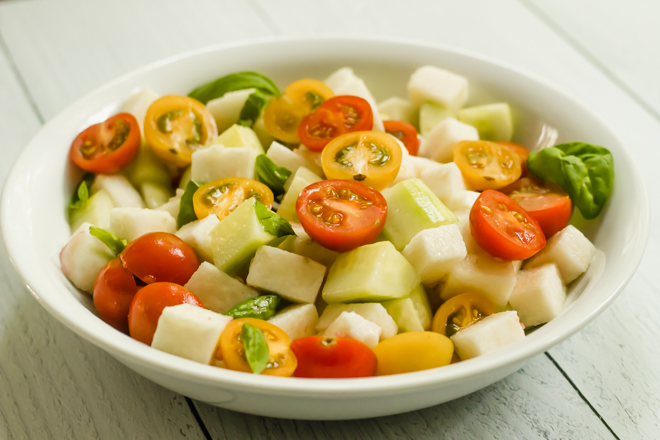 white bowl with mixed diced vegetables