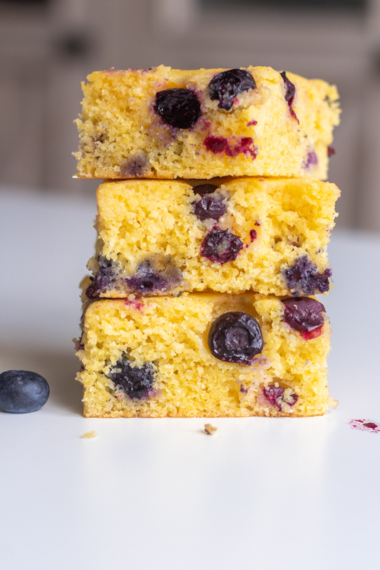 straight on view of 3 slices of blueberry cornbread stacked on top of each other