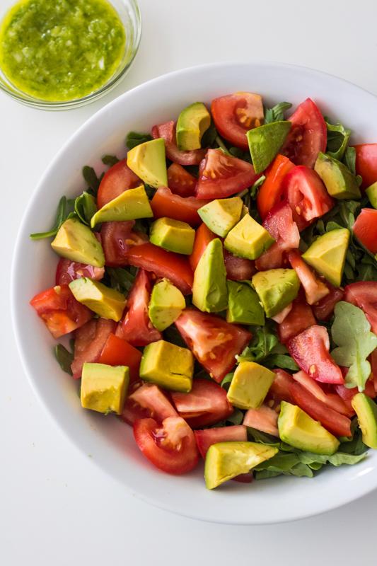 avocado tomato salad in a bowl overhead