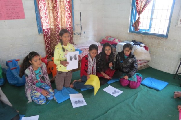 Nirupa explaining about women violence through the picture she chose