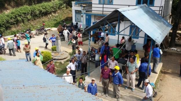 volunteers gather to help deconstruct ASC building