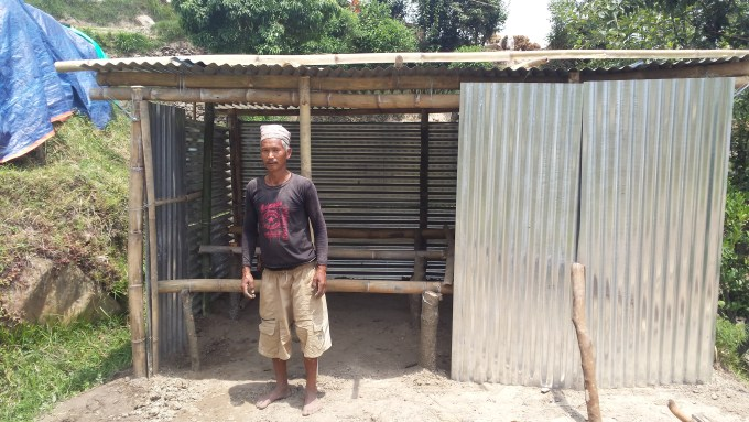 4 father of anju theeng_standing in front of temp shed_simpani