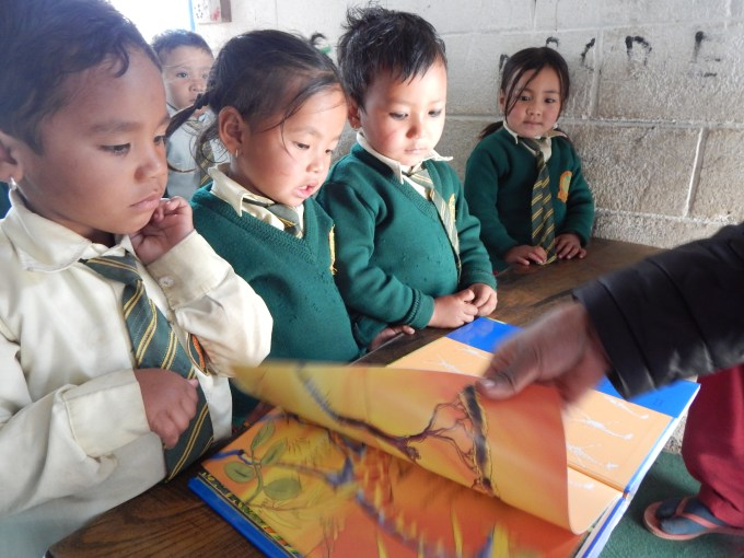 Nursurry Students while reading books