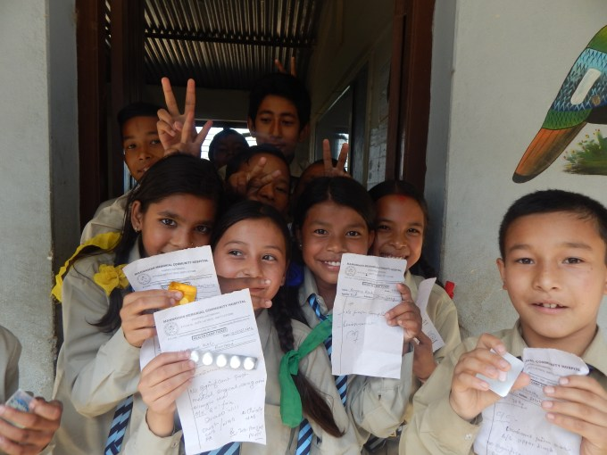 happy students_ they express their happiness for receiving health service at their doorstep