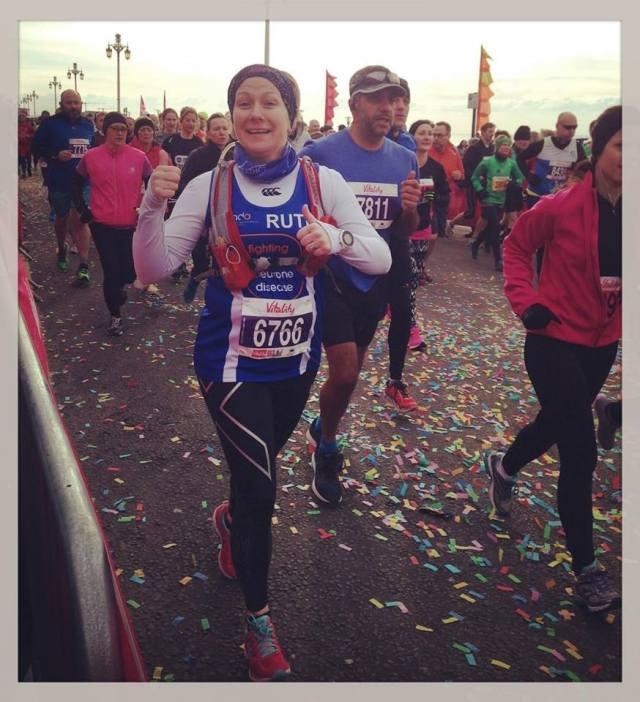 Rularuns running with thumbs up at start of Brighton Half Marathon
