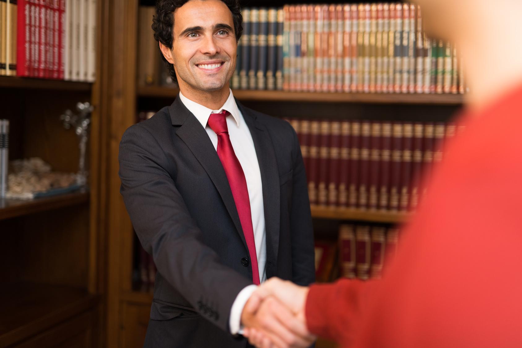 Businessman Giving An Handshake To A Customer Rulon T Burton