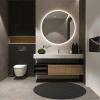 Design kamar mandi modern dengan cermin dan karpet bulat