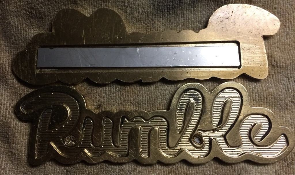 Rumble Tank emblem in brass