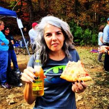 Karen with beer and pizza - Photo by Bren Tompkins