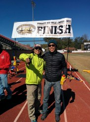 Me at the finish line with the real finisher, Chang, 11th overall.