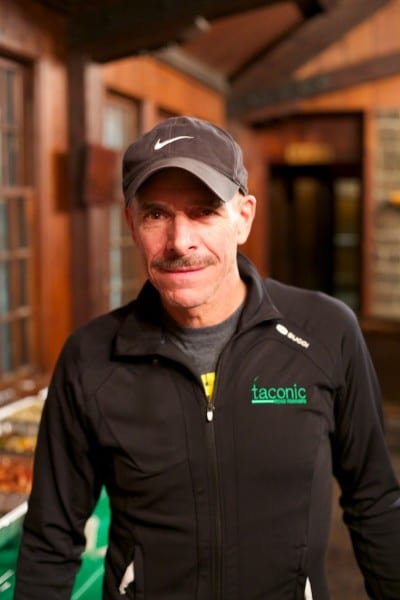 Mike Moccia is wearing the Men's Sugoi 3/4 zip with embroidered logo