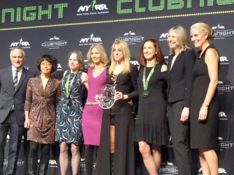 Ted Pernicano - Woman's 50 team award on stage