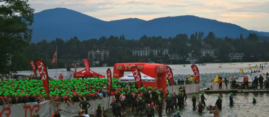 The swim had just begun, as athletes wait in corrals for their turn to go under the red arch and start their swim.