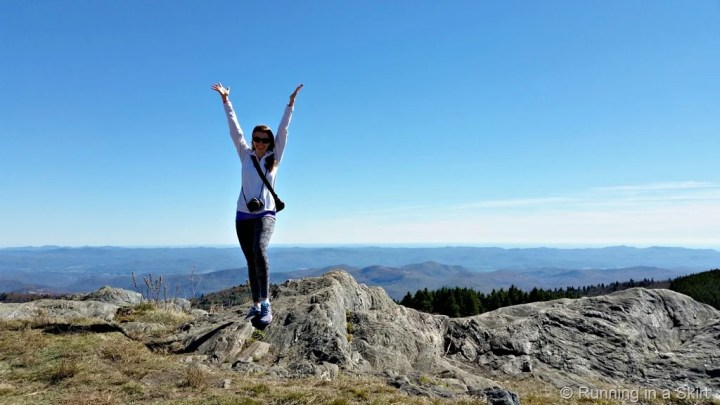 Girl standing at the top of Black Balsam.
