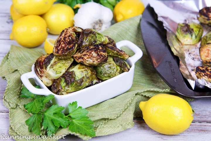 Roasted Brussels Sprouts with Garlic in a white serving dish.