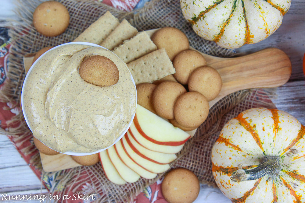 Overhead shop of Pumpkin Dip in a white bowl with dippers.