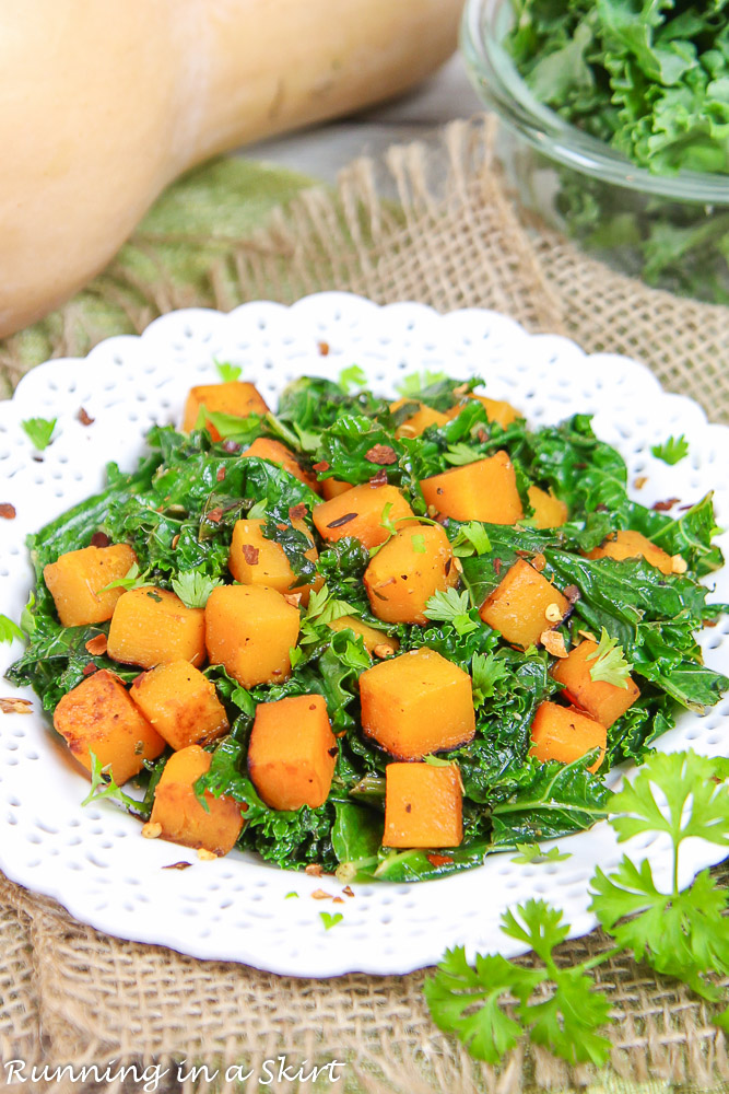Butternut squash and kale on a white plate.