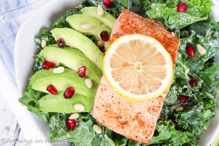 Baked Salmon Kale Salad recipe with Tahini Dressing in a white bowl.