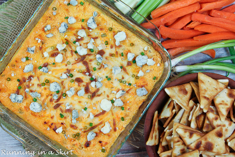 Buffalo Shrimp Dip with carrots, celery and pita chips.