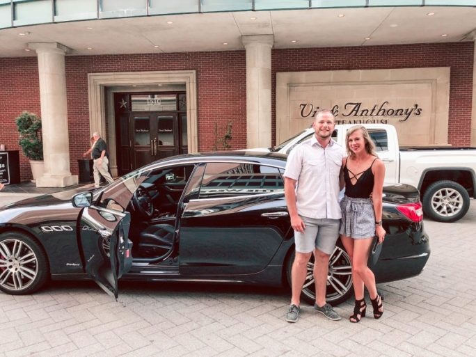 Where to stay in Houston: Hotel Alessandra   black Maserati sits outside of Vic and Anthony's Steakhouse while Dallas blogger, Running in heels stands outside posing with her boyfriend.