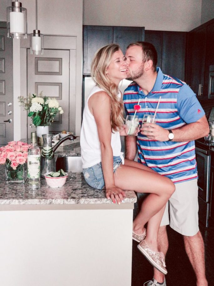 Ketel One Botanical   Boyfriend and girlfriend in apartment drinking cucumber and mint drinks