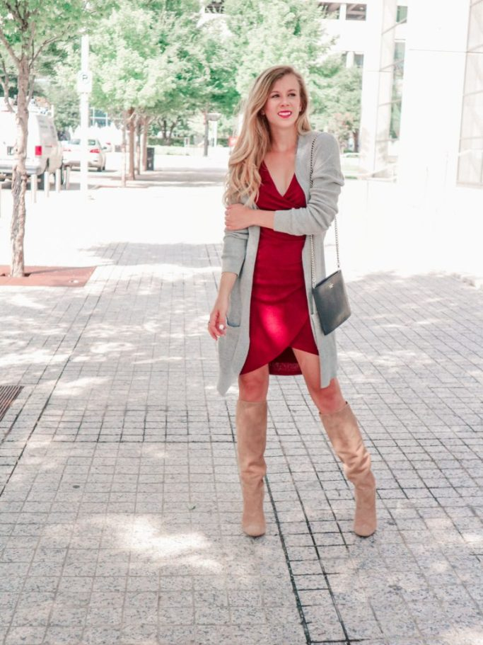 Slouch suede tall boots, the new boot trend, featured by top US fashion blog, Running in Heels: image of a blonde girl wears a red bodycon ruched dress with long gray cardigan, tan slouch boots by Sam Edelman