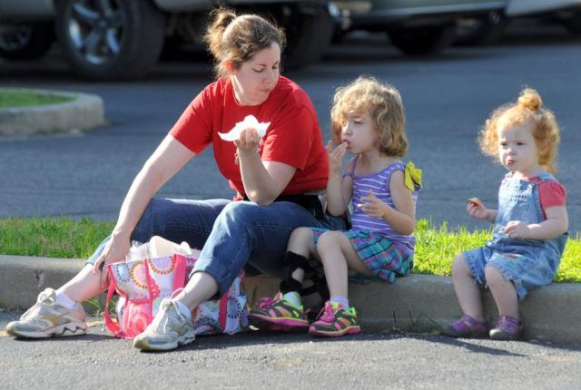 Tribune-Star/Bob PoynterYummy: Jennifer Schwab and her daughters Lucy (4) and Emerson (2) enjoy some pecan rolls during their trip to the Farmers Market Saturday morning.