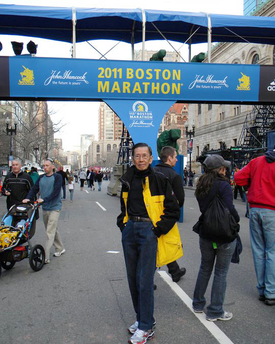 Kor posing at the Boston Marathon race site