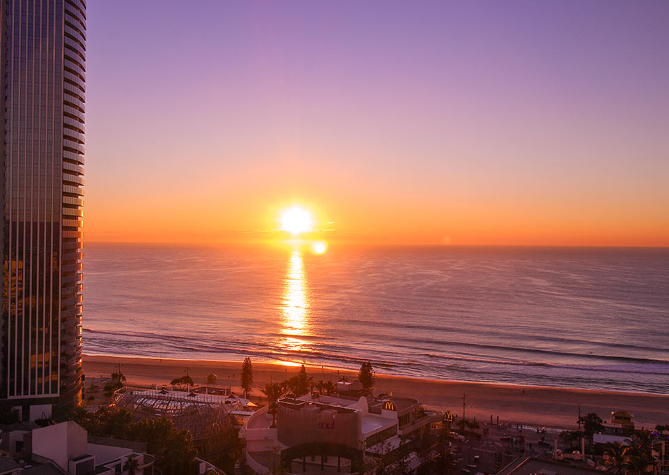 Staying at the upper floors of Grand Chancellor Hotel gives you spectacular views of the Gold Coast sunrise.
