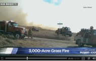 Grass fire comes close to rural homes near Marquette