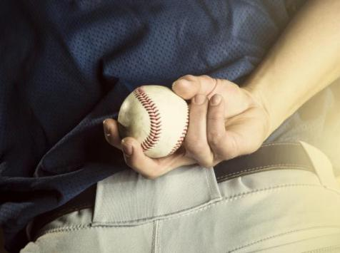 baseball player with baseball