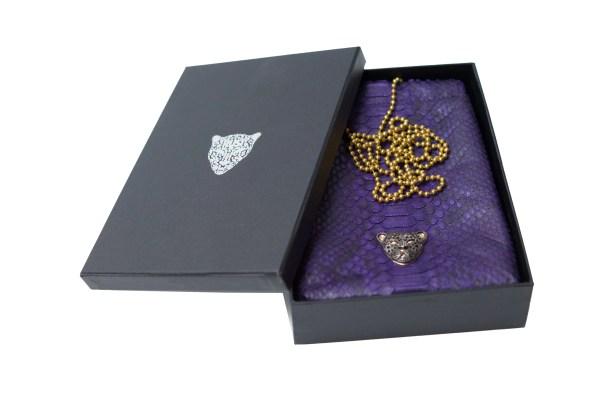 Purple Capsule Clutch with black logo RusiDesigns