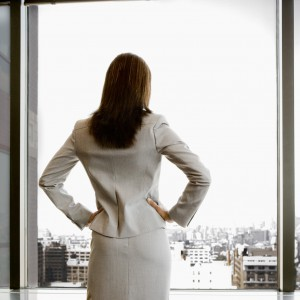 Rear view of woman looking out window  Accident Attorney Orange