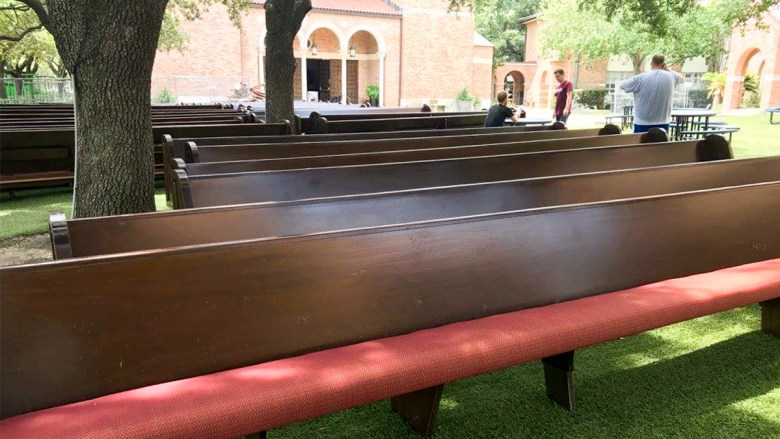 pews outside flooded church