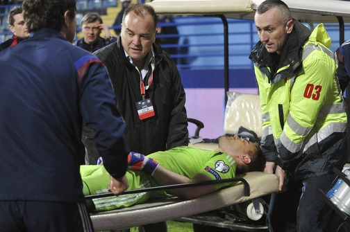 Russia's goalkeeper Akinfeev, hit with a flare in the head, is transported during the Euro 2016 Group G qualifying soccer match against Montenegro in Podgorica