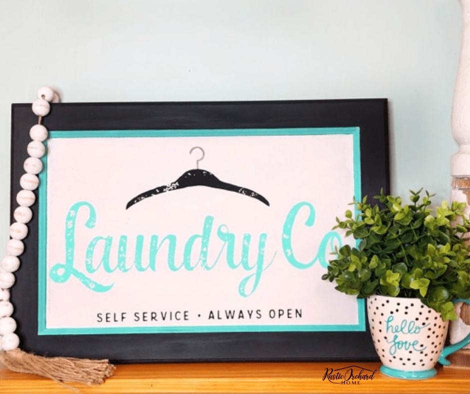Create an adorable farmhouse sign for your laundry room with this tutorial. This project is super easy and budget friendly. #rusticorchardhome #farmhousehomedecor #homedecoronabudget #chalkcouture