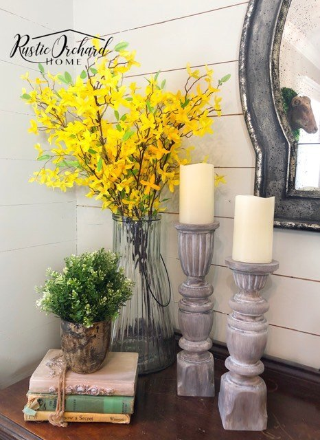 Learn how to make wooden candlesticks from repurposed spindles. This is a budget friendly spring farmhouse home decor diy you'll love! #rusticorchardhome #woodencandlesticks #budgetfriendlydiy #springfarmhousehomedecordiy #springfarmhousedecor
