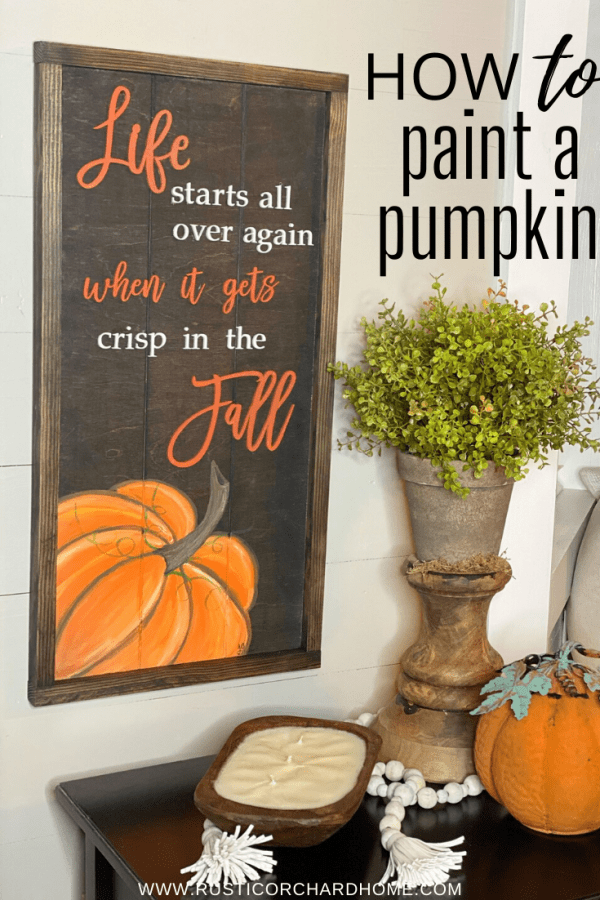 Learn how to paint a pumpkin freehand with this simple fall farmhouse sign tutorial!