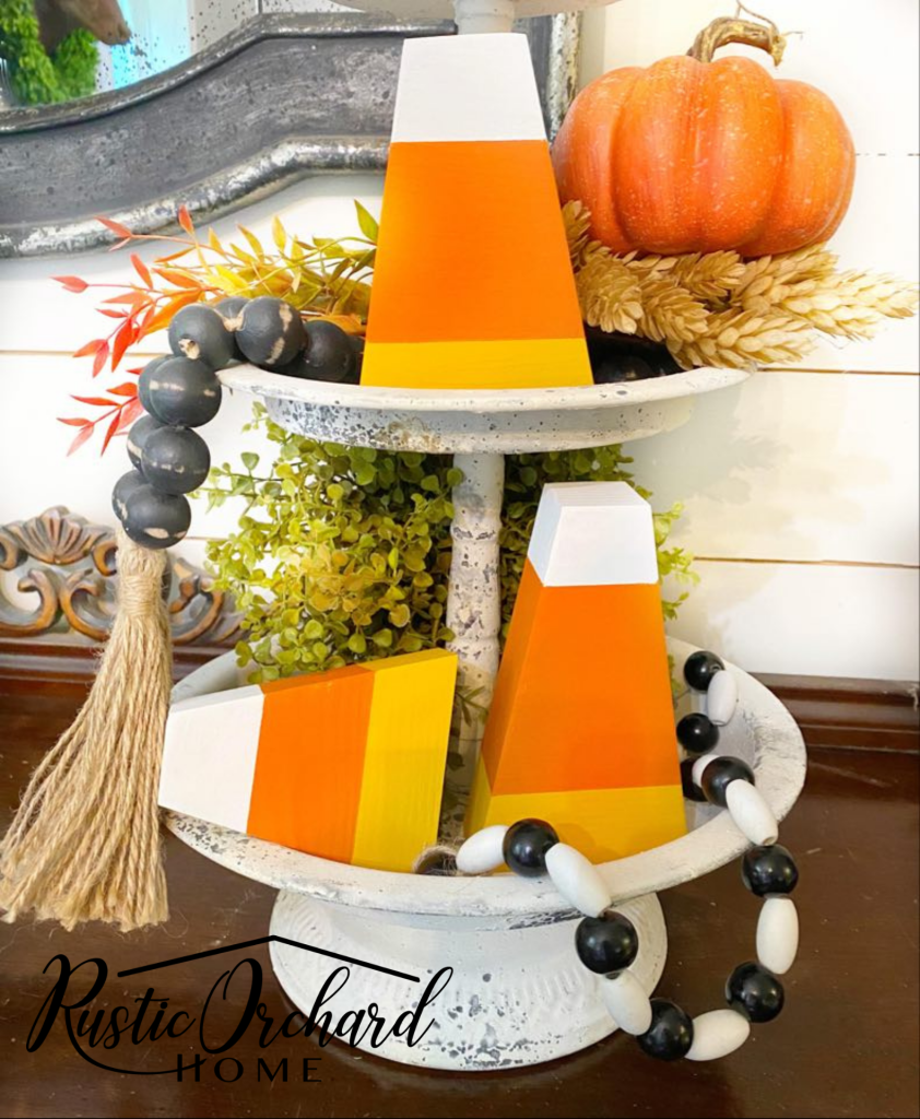 This DIY Candy Corn Decor tutorial is super easy and budget friendly. Dress up your fall home with this crafty idea!