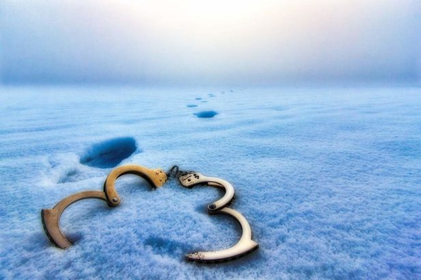 Perspective - Handcuffs in the snow