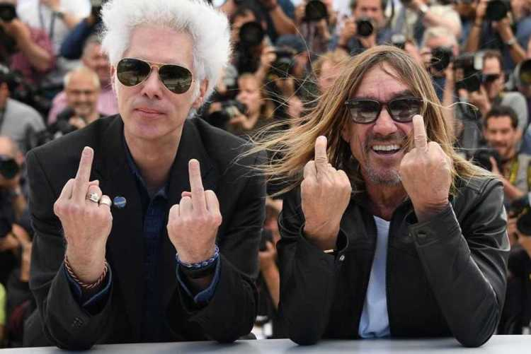 TOPSHOT - US director Jim Jarmusch  L  and US singer Iggy Pop give the fingers while posing on May 19  2016 during a photocall for the film  Gimme Danger  at the 69th Cannes Film Festival in Cannes  southern France     AFP PHOTO   ANNE-CHRISTINE POUJOULAT