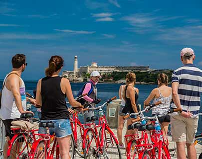 Bike ciity tour in front of morro castle havana cuba