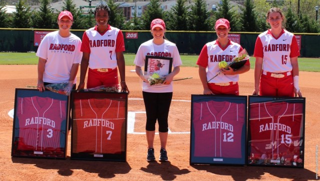 From left: Casey Burns, Nia Chiles, Megan Honake, Becky Mantel, and Whitney Davis are honored before the game.
