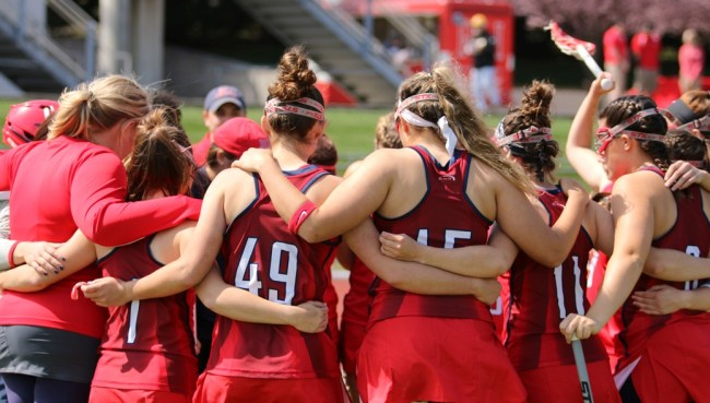 Women's lacrosse huddles up before Saturday's game against High Point.