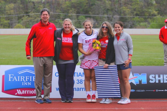 From left: Athletic Director Robert Lineburg, Lacrosse Head Coach Haley Marvine, Emily Hoke, Hoke's mother, and Assistant Coach Julia Heaps.